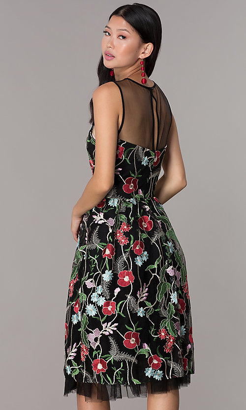 Image of knee-length embroidered-mesh black party dress. Style: ECI-718729-46153 Back Image