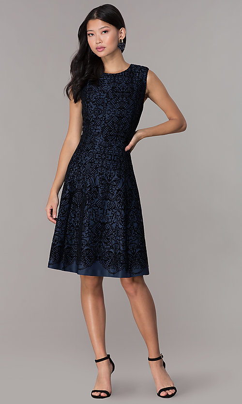 Image of short flocked holiday party dress in navy blue. Style: ECI-720401-8279 Detail Image 3