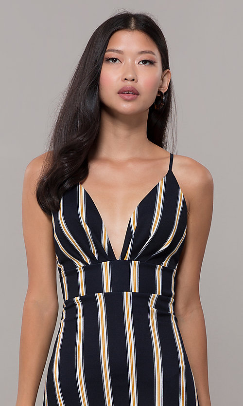 Image of striped high-low empire-waist wedding guest dress. Style: CL-46953 Detail Image 1