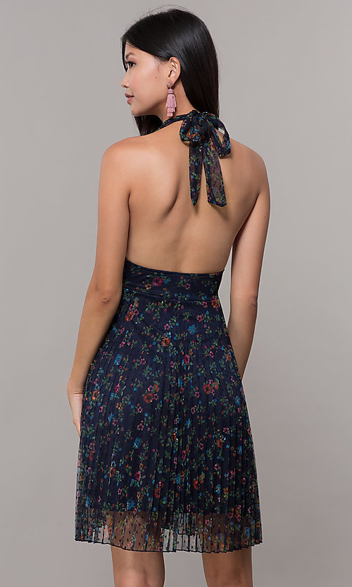Image of floral-print pleated short navy wedding-guest dress. Style: CL-7603P Back Image