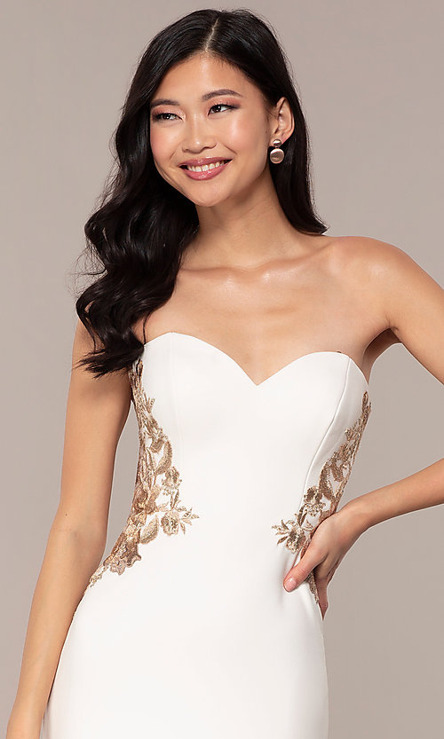 Image of Faviana long ivory strapless formal prom dress. Style: FA-S10304 Detail Image 1