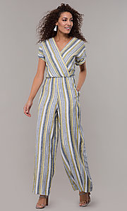 Image of striped short-sleeve long jumpsuit with pockets. Style: ECI-720476-8099A Front Image