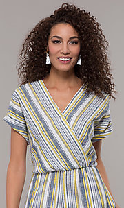 Image of striped short-sleeve long jumpsuit with pockets. Style: ECI-720476-8099A Detail Image 1