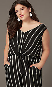 Image of plus-size party jumpsuit with v-neckline. Style: AS-A121347A40X Detail Image 1