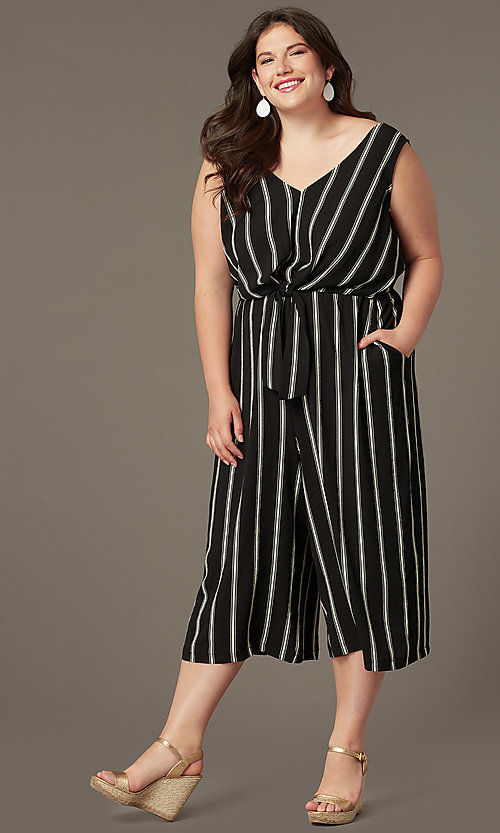 Image of plus-size party jumpsuit with v-neckline. Style: AS-A121347A40X Front Image