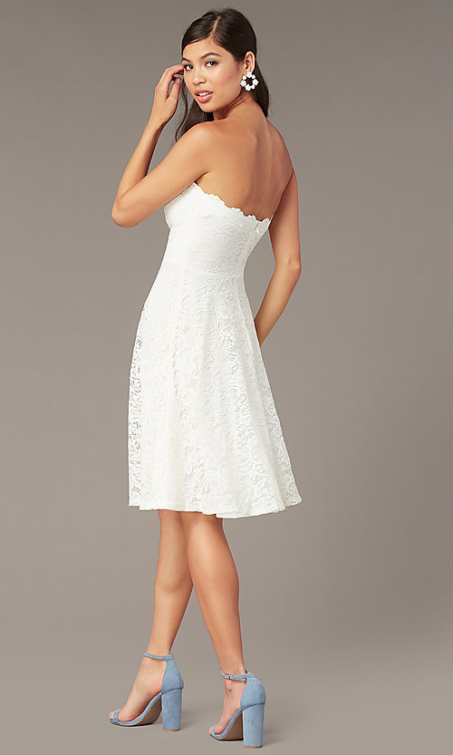 Image of short ivory white lace strapless party dress. Style: JU-10394D Back Image