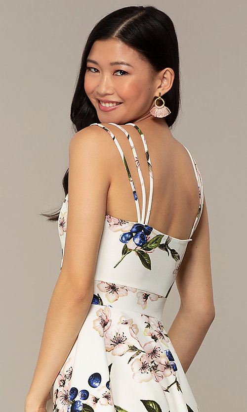 Image of short strappy floral-print graduation party dress. Style: DC-D47329 Detail Image 2
