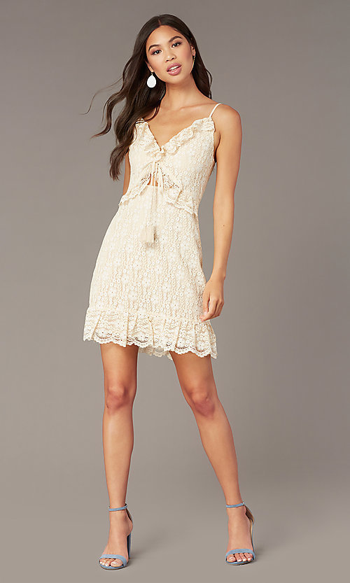 Image of cream short lace party dress with ruffles. Style: STO-SD1935A Front Image