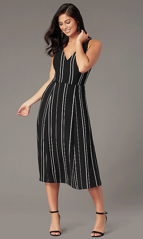 Image of knee-length casual party dress in black and white. Style: EM-HLD-4219-020 Front Image
