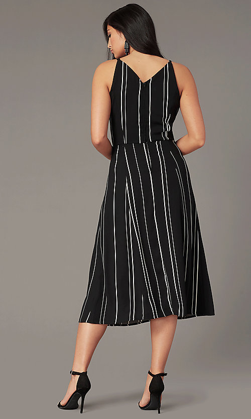 Image of knee-length casual party dress in black and white. Style: EM-HLD-4219-020 Back Image