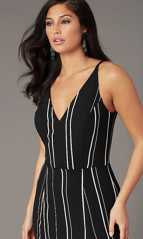 Image of knee-length casual party dress in black and white. Style: EM-HLD-4219-020 Detail Image 1