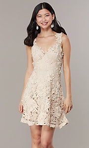 Image of short taupe a-line party dress in embroidered lace. Style: JTM-JMD10396 Front Image