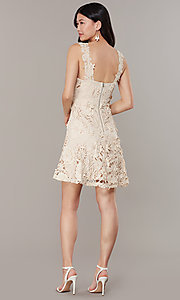 Image of short taupe a-line party dress in embroidered lace. Style: JTM-JMD10396 Back Image