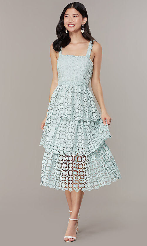 Image of sage green tiered-lace midi wedding-guest dress. Style: JTM-JMD10613 Front Image