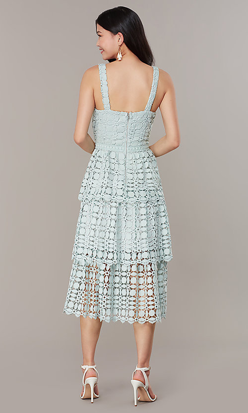 Image of sage green tiered-lace midi wedding-guest dress. Style: JTM-JMD10613 Back Image