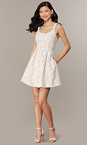 Image of short white lace graduation dress with pockets. Style: CHE-D16131CYN Front Image