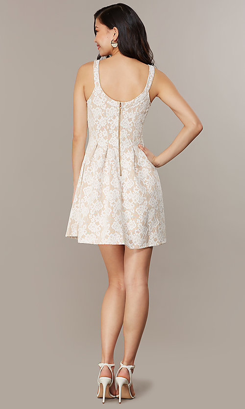 Image of short white lace graduation dress with pockets. Style: CHE-D16131CYN Back Image