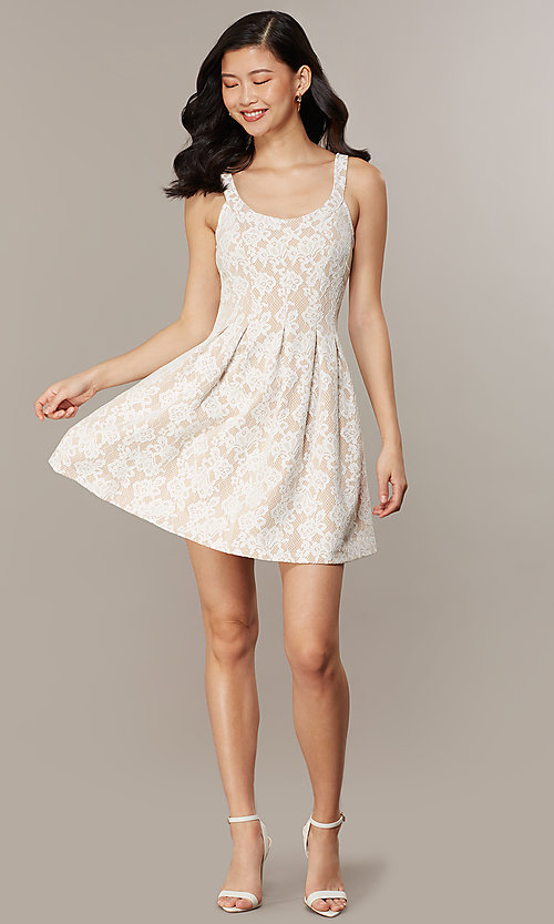 Image of short white lace graduation dress with pockets. Style: CHE-D16131CYN Detail Image 2