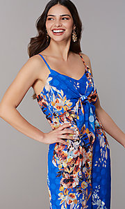 Image of blue floral-print cropped-leg jumpsuit. Style: ECI-720469-75851 Detail Image 1