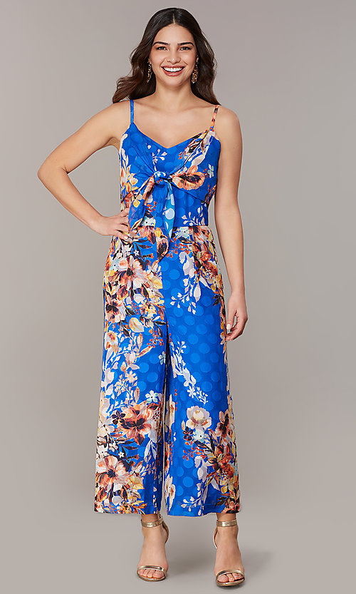 Image of blue floral-print cropped-leg jumpsuit. Style: ECI-720469-75851 Front Image