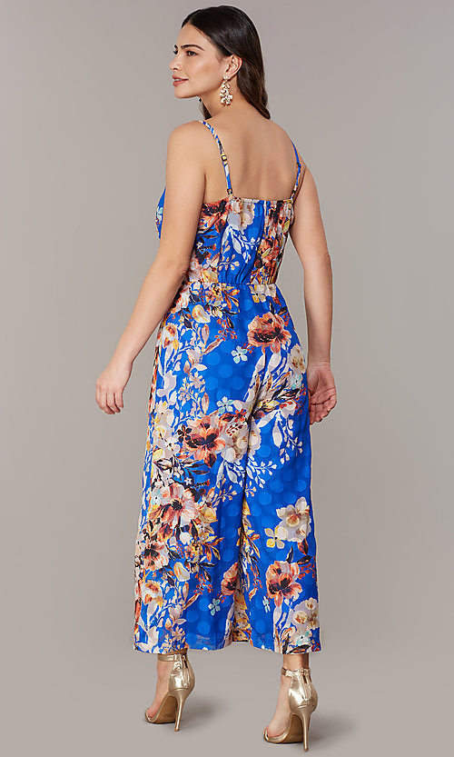 Image of blue floral-print cropped-leg jumpsuit. Style: ECI-720469-75851 Back Image