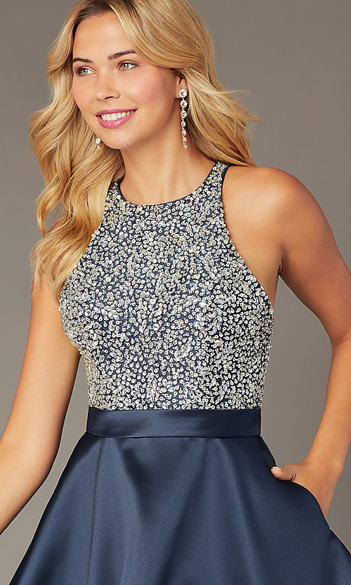 Image of short navy homecoming dress from JVNX by Jovani. Style: JO-JVNX00383 Detail Image 1