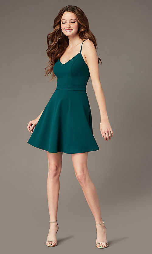 Image of evergreen lace-back short party dress with pockets. Style: SS-D77562DNE Back Image