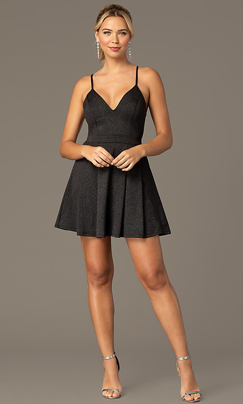 Image of glitter-knit short black homecoming party dress. Style: MCR-PL-2909 Front Image