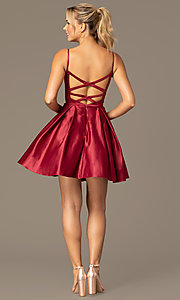 Image of short caged-back a-line party dress with pockets. Style: NA-N670 Detail Image 6