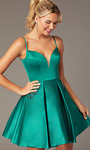 Image of short caged-back a-line party dress with pockets. Style: NA-N670 Detail Image 1