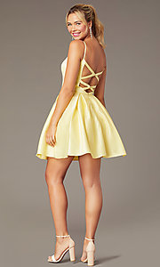 Image of short caged-back a-line party dress with pockets. Style: NA-N670 Detail Image 3