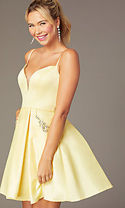 Image of short caged-back a-line party dress with pockets. Style: NA-N670 Detail Image 4