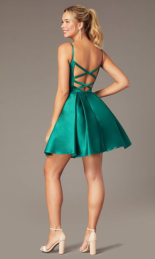 Image of short caged-back a-line party dress with pockets. Style: NA-N670 Back Image