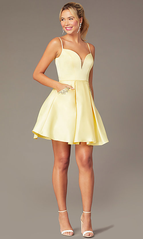 Image of short caged-back a-line party dress with pockets. Style: NA-N670 Detail Image 2