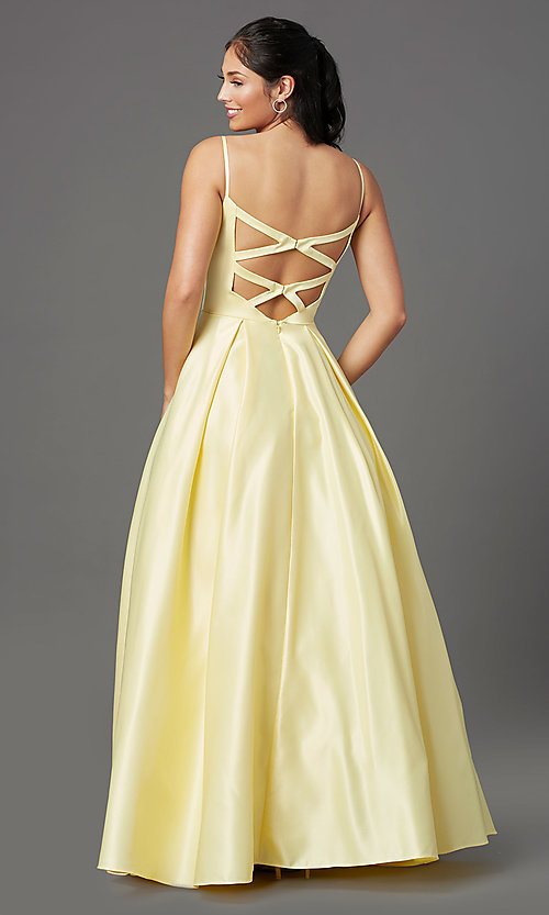 Image of open-back lemon yellow prom dress with pockets. Style: NA-PL-N308 Back Image
