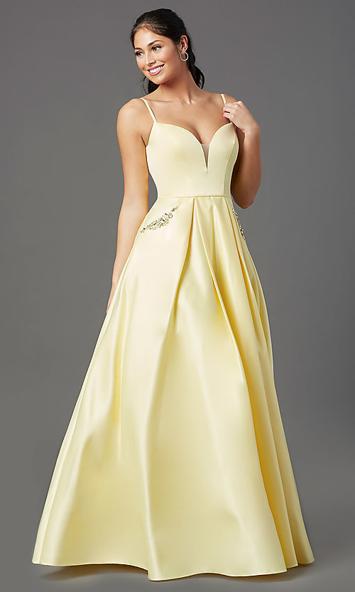 Image of open-back lemon yellow prom dress with pockets. Style: NA-PL-N308 Detail Image 2