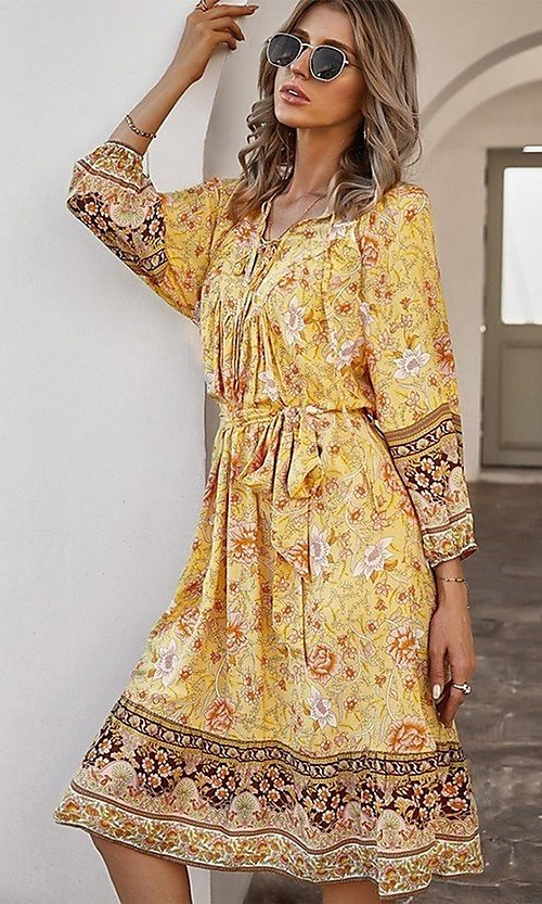 Image of casual knee-length print dress with sleeves. Style: LAS-ESL-21-49363DDY Back Image