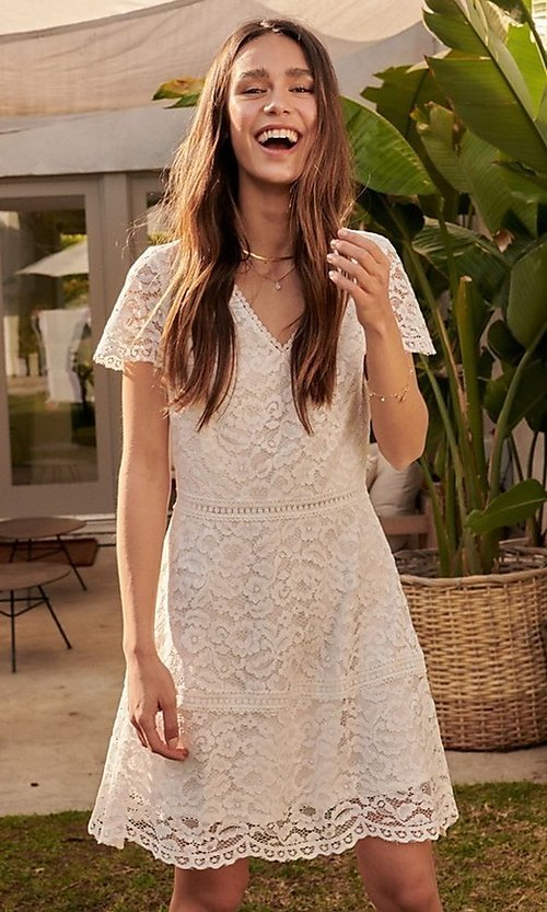 Image of off white lace short sleeve graduation party dress. Style: LAS-PRO-21-NDR0607 Front Image