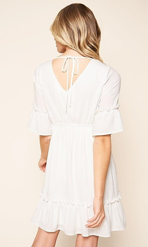 Image of short white casual party dress with short sleeves. Style: FG-BNB-21-SLD69003 Back Image