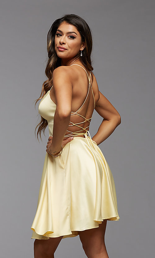 Image of open-back short homecoming dress with side pockets. Style: PG-THC-21-51 Detail Image 3