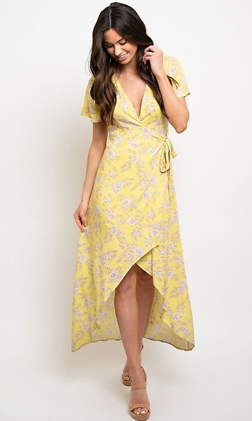 Image of wrap-style yellow print high-low party dress. Style: FG-CLC-21-D8358WT Front Image
