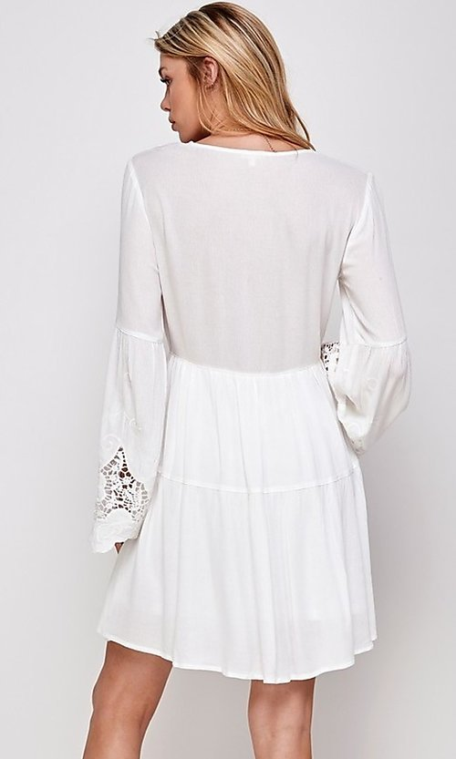 Image of short white party dress with long bell sleeves. Style: FG-ECR-21-ED16228TNA Back Image