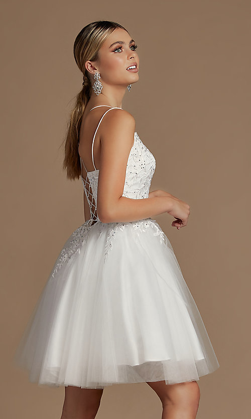 Image of embroidered a-line short corset-back hoco dress. Style: NA-21-T718 Back Image